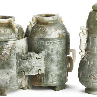 A Chinese double vase and covered vase of greenish jade