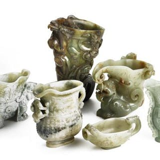 Six Chinese drinking cups and vessels of green jade...