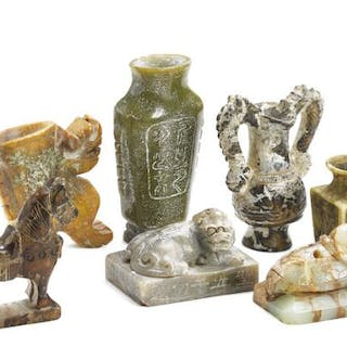 A group of seven Chinese miniature figures of green and brownish jade