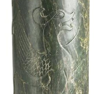 A Chinese vase of spinach-green jade carved in relief...