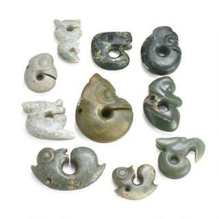 Ten circular ornaments of greyish and brownish jade carved with masks