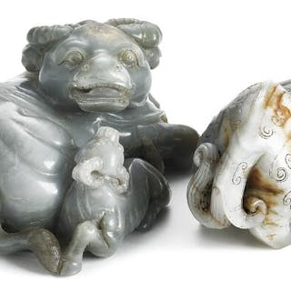 Two Chinese figurines of grey jade in the shape of a...