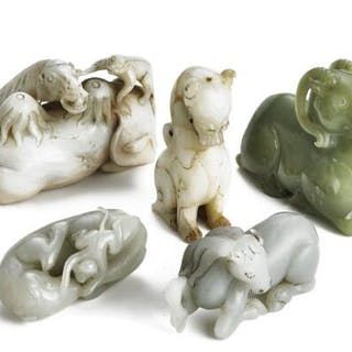 A group of five Chinese figurines of green and greyish...