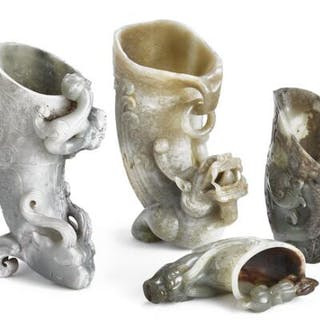 Four Chinese jade rhytons carved with chilong dragons and design in