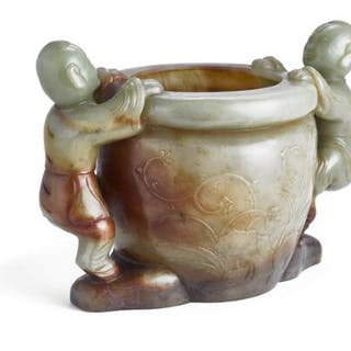 A Chinese green and russet jade censer carved in the shape of two laughing boys