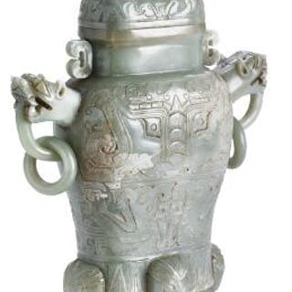 A Chinese covered vase of green jade. Weight 1246 g. L. 24 cm.