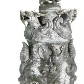 A Chinese three-part covered vase of greyish jade carved with dragons