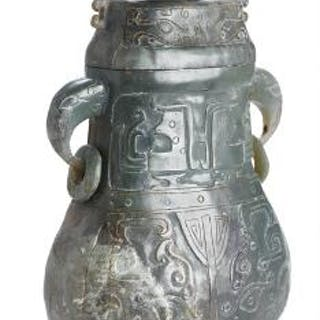 A Chinese covered Hu vase of green jade