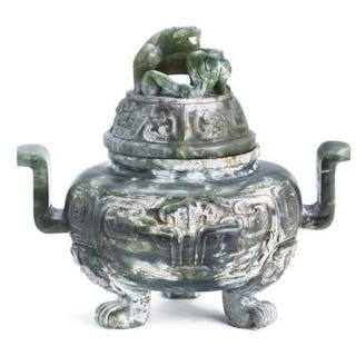 A Chinese censer of green jade mounted upon three animal paws
