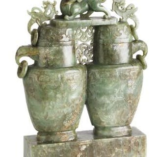 A Chinese covered double vase of green jade. Weight 3983 g. H. 33 cm.