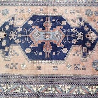 A Pakistani carpet in classical Caucasian design. Late 20th century.