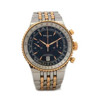 Breitling: A gentleman's wristwatch of 18k gold and steel