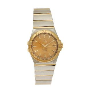 Omega: A gentleman's wristwatch of 18k gold and steel