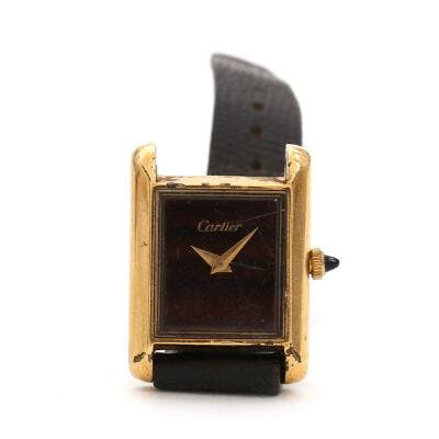 Cartier: A lady's wristwatch of gold-plated metal