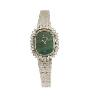 Omega: A lady's wristwatch of 14k white gold