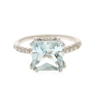 An aquamarine and diamond ring set with a fancy-cut...