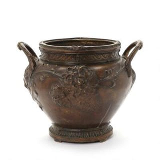A large French 19th/20th century patinated bronze vase cast with two handles