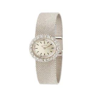 Corum: A lady's wristwatch of 18k white gold