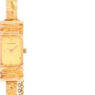 Lapponia: A lady's wristwatch of 14k gold with integrated bracelet