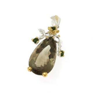 A prasiolite pendant set with a pear shaped prasiolite...