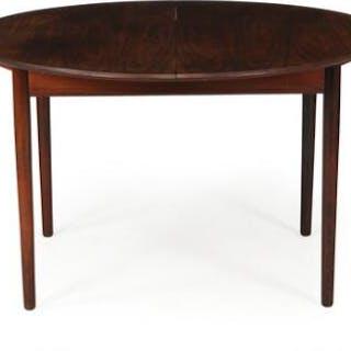 Ib Kofod-Larsen: Circular Brazilian rosewood dining table...