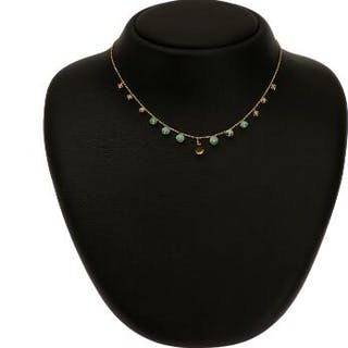 Natascha Trolle: An emerald and citrine necklace set with...