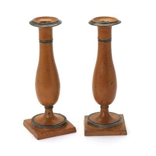 A pair yellow painted pewter candlesticks