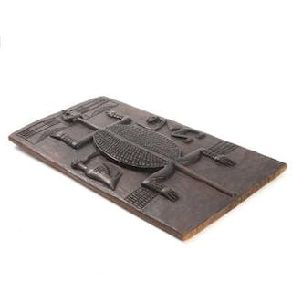 A carved wood Dogon relief. Ghana. 20th century. 60×33 cm.