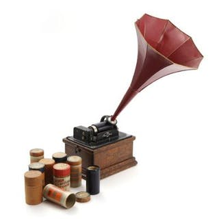 Edison cylinder phonograph in an oak case with red horn