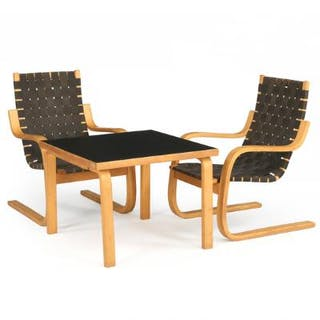 Alvar Aalto: A pair of easy chairs and coffee table of birch