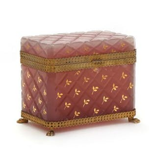 Four sided glass casket with gold leaf decoration