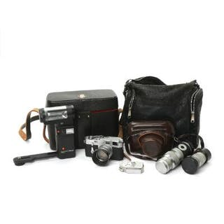 Leica M3 camera no. 708916 with leather bag and four lenses.