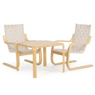 Alvar Aalto: A pair of easy chairs of birch and a coffee table of ash