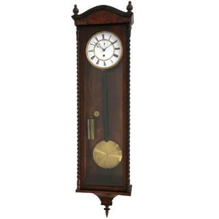 A regulator wall clock with rosewood case