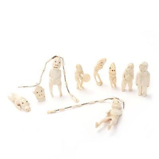 Collection of carved sperm whale tusk tupilaks and figurines