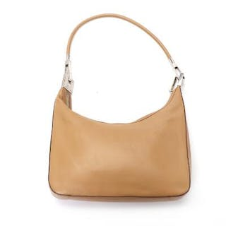 Gucci: A bag of light brown leather
