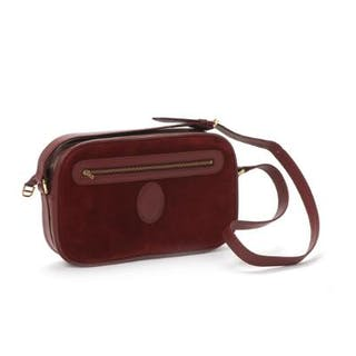 Cartier: A vintage shoulder bag of red suede and leather