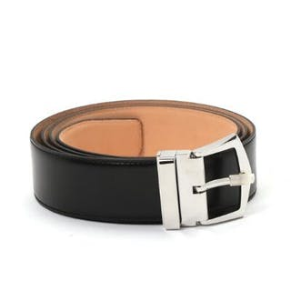Patek Philippe: A belt of black leather with silver coloured buckle