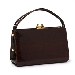 A vintage snake skin handbag with golden hardware