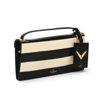 Valentino: A black and beige leather clutch with handle