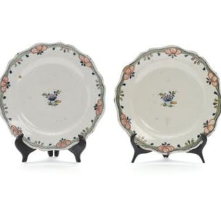 A pair of 19th century Rouen faience plates with scallop rim