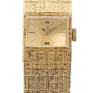 Omega: A lady's wristwatch of 14k gold with integrated bracelet