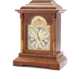 An early 20th century German mahogany mantel clock. H. 40.5 cm.