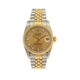 Rolex: A lady's wristwatch of 18k gold and steel
