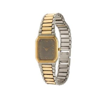 Omega: A lady's wristwatch of steel and gold plated metal