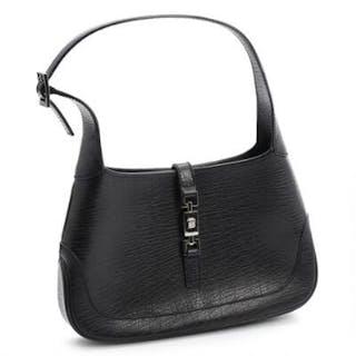 Gucci: A black leather handbag