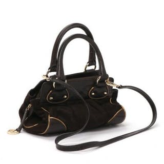 Max Mara: A bag of brown leather with embossed brown leather