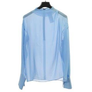 Emilio Pucci: A blouse of blue silk