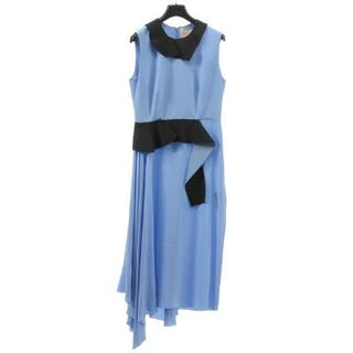 Roksanda: A dress of blue silk withdetails in black...