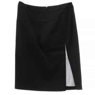 Etro: A pencil skirt of black fabric with a white detail and a slit